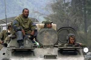 Russian troops sit on an amoured vehicle in the South Ossetian settlement of Dzhava
